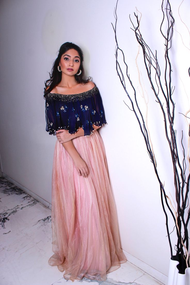 Midnight Blue Off-The-Shoulder Lehenga: Georgette and swiss net midnight blue off-the-shoulder crop top with pearl, ribbon and sequin embroidery with pink high-wasted skirt