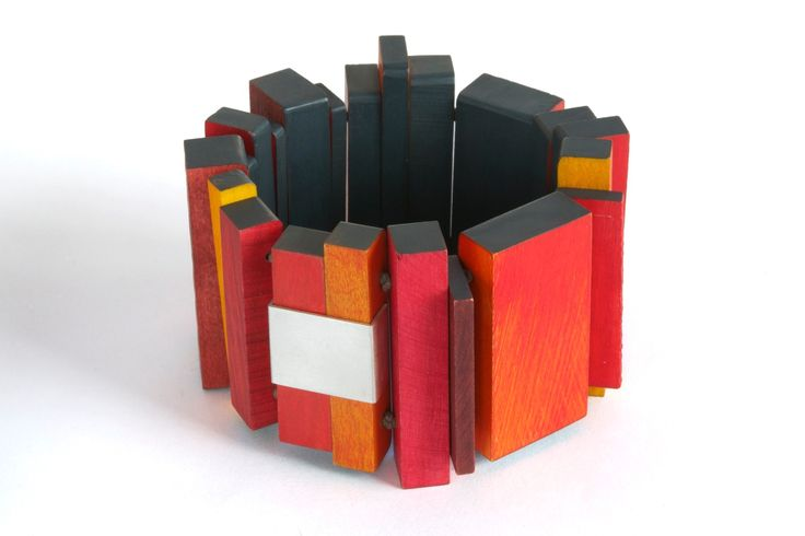 "Julia Turner ""Red Mill Bracelet"", 2014. Wood, stain, cord, magnets, sterling silver. 2.5 x 7 x .5 in (6.4 x 17.8 x 1.3 cm)."
