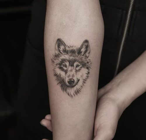 58dc95910 48 Powerful Wolf Tattoo Designs (Tribal, Traditional, & Lone Wolf Tattoos)  | Wolf tattoo design | Wolf tattoos, Small wolf tattoo, Wolf tattoo design