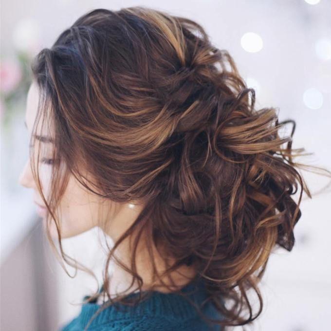 Messy curly high bun