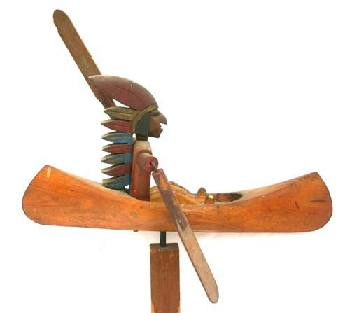 antique folk art whirligig - Indian in canoe -- LOL, Plains Nation in a Great Lakes Canoe