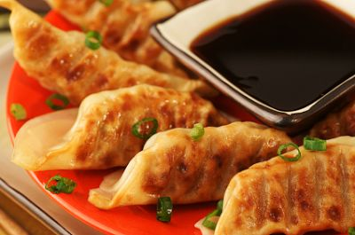 Japanese-style Gyoza are related to their Chinese counterparts but tend to be more subtle in flavor, stuffed with juicy beef and cabbage lightly seasoned with garlic, scallions, white pepper, salt, and sugar.