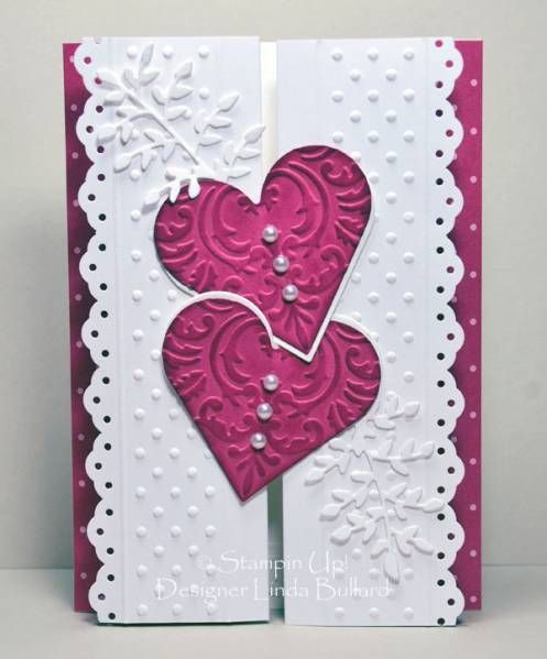 The card base is 5 1/2 x 12, scored at 2, 4, 8 and 10 inches. I used the Eyelet Border punch on the sides and then embossed with the dots border folder and my Scor-pal.  The interlocking hearts are my closure. It took a few test runs before I got them working decently. For sturdiness there are two layers, one white and the other Rose Red, cut out with the nestabilities heart die. The Rose Red hearts are embossed with the Jamara embossing folder and sponged with Rose Red ink for more…