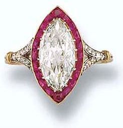 This diamond and ruby ring was given to HRH the Duchess of York (who later became Queen Mary) in 1893, as a wedding gift from her father-in-law, the Prince of Wales (who later became King Edward Vii). The ring is a Marquise shaped diamond with rubies set in platinum and gold.