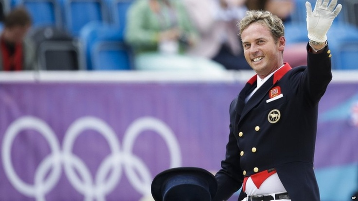 Carl Hester waves to crowd riding Uthopia for Team GB