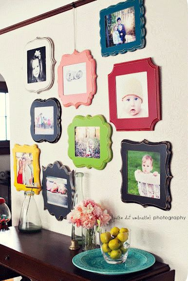 Love the different shapes and colors of frames on this photo wall.  LOTS of family photo ideas!