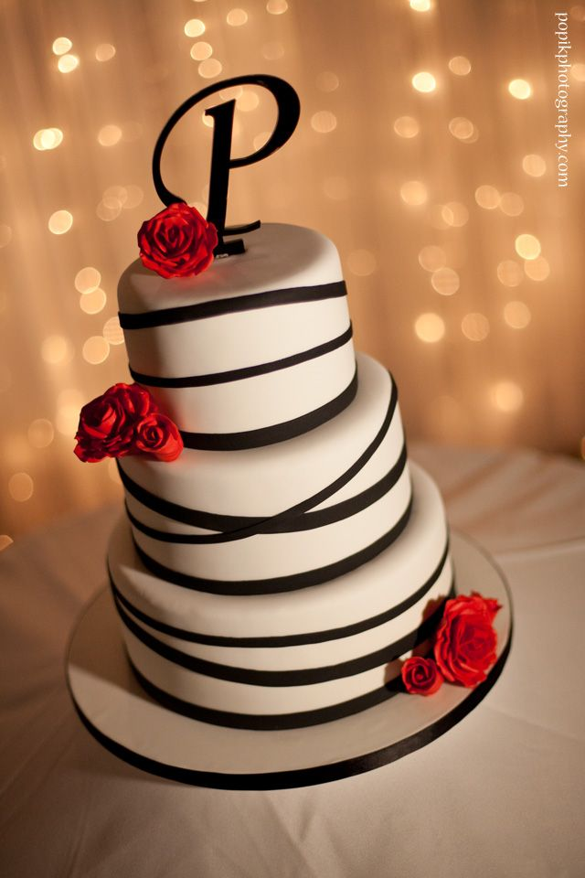 Gorgeous black and white with roses wedding cake