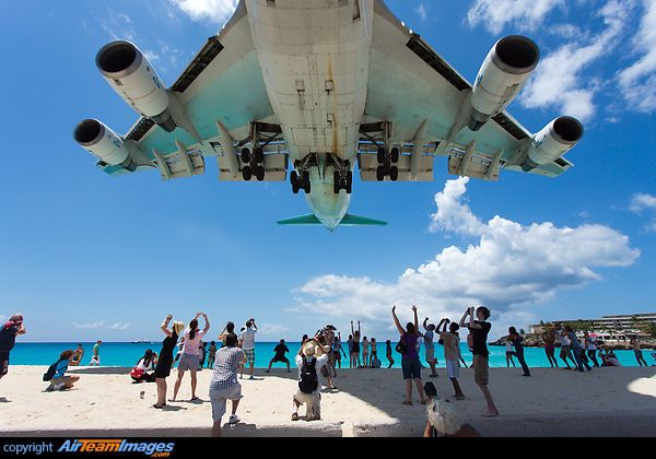 A KLM Boeing 747-406 flying very close above Maho beach, coming in for landing at Princess Juliana Airport, St Maarten.