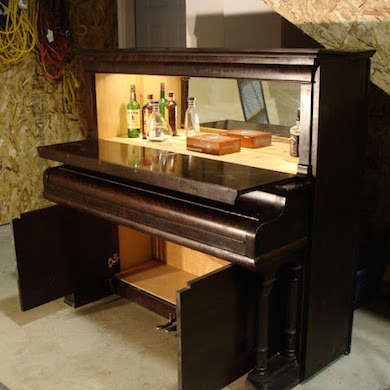 Piano Bar  Here's one piano bar that really lives up to its name. But, don't feel limited by the wordplay. Your old upright or grand piano can be converted into any number of useful pieces, from bookshelves to workbenches. All it takes it a little ingenuity and vision.