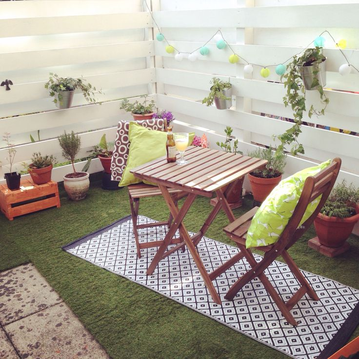 Our New Purchase  Artificial Grass For The Patio. With IKEA Furniture,  Cushions And Rug. We Used Fruit Crates To Raise Small Plant Pots And  Punched Holes ...