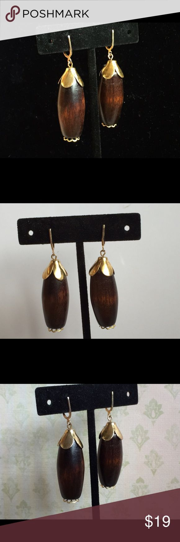 "Classic Vintage Boho Wood Pendant Dangle Earrings For your consideration are these Classic Vintage Boho Wood Pendant Dangle Earrings. Perfect for summer and you can rest assured these are authentic vintage earrings. Totally green for the consumer who values keeping our footprint ""green.""  These measure approximately 2 inches long and 1/2"" wide. Screw clip. Excellent condition. Jewelry Earrings"