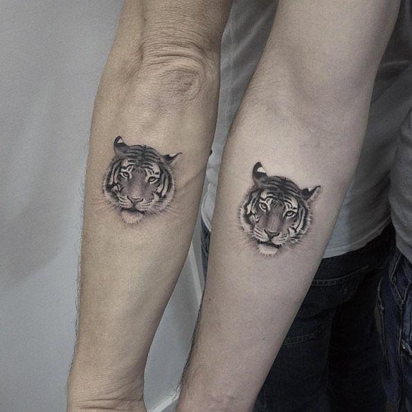 Matching tiger tattoos by Elizabeth Markov