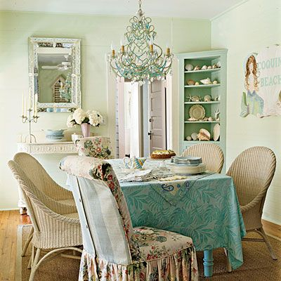 Coastal Living - This sea-hued dining room strikes the ideal balance between formal and relaxed, with its fanciful chandelier and soft chintz slipcovers. Shells, sea stars, and a playful mermaid ensure that you won't forget you're at the beach.
