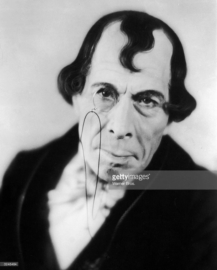 Promotional portrait of British actor George Arliss (1868 - 1946) wearing a monocle in costume as British prime minister Benjamin Disraeli for the film, 'Disraeli,' directed by Alfred Green.