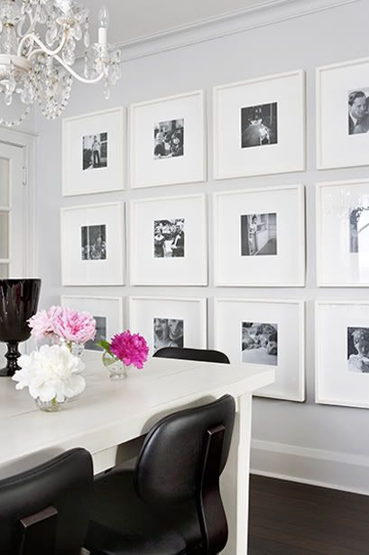 black and white photos in white frames