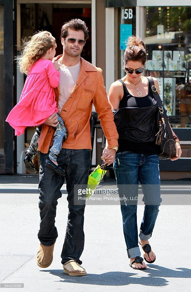 Malibu, California, May 9, 2010 BROOKE BURKE and DAVID CHARVET, out with their daughter HEAVEN RAIN shopping at Planet Blue in Malibu. PGpg68