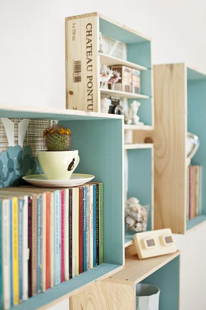 Transforming wooden crates into wall shelving, the pop of turquoise in the inside makes it even more of a custom look   DIY for Home & Fashion