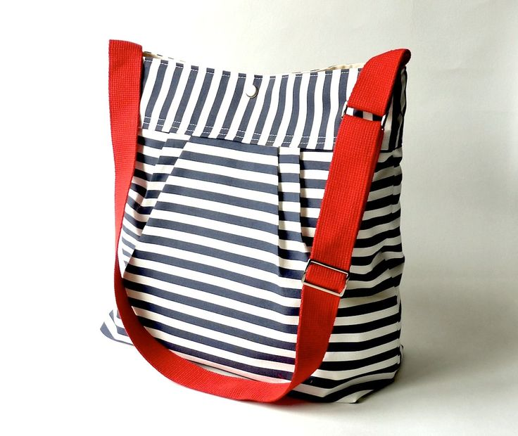Featured on The Martha Stewart BEST SELLER Diaper bag/Messenger bag STOCKHOLM Navy blue and white nautical striped - Hgtv Baby talk magazine. $89.00, via Etsy.