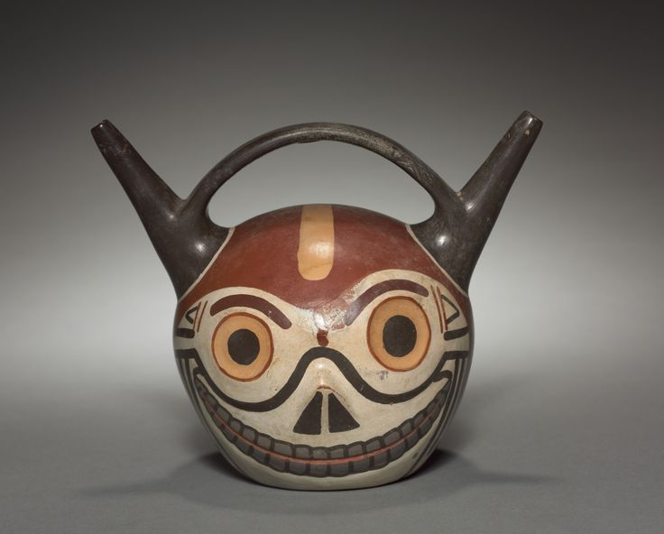 Skull Vessel   Cleveland Museum of Art  Wari (Pachacamac) style, Middle Horizon, Epoch 2  earthenware with colored slips