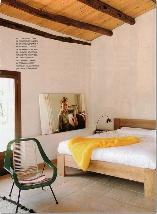 I adore that bed frame.  That yellow throw is neat, too.