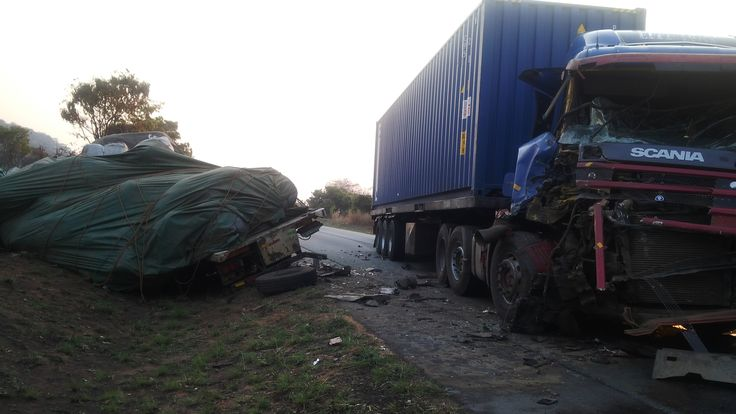The other truck fell over (left) after head-on collision with the Scania truck on the right. [Road Safety First!]