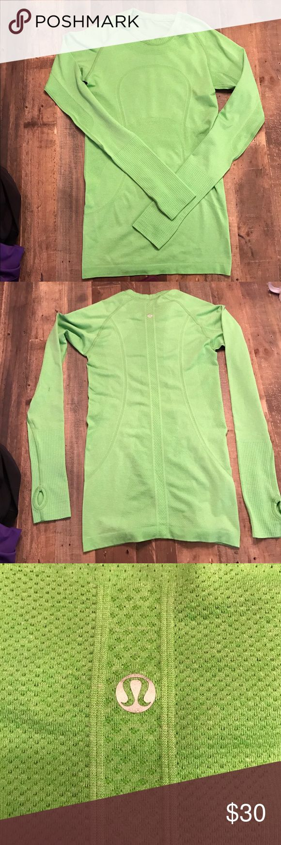 Lululemon Neon green long sleeve top. Worn twice, great condition, no pilling. lululemon athletica Tops