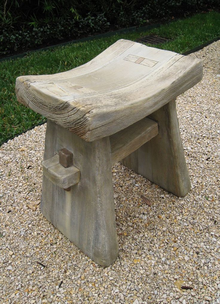 Beautiful concrete work, made to look like a rustic wood stool.