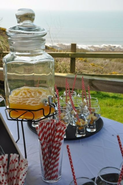 Want to go for something a little different for your drinks for your wedding but cant decide. Why not go for drinks dispensers. Its an easy fun way for all your guests to help them selves. And look at view over the Atlantic Ocean from Ocean Kave coastal wedding in North Devon.