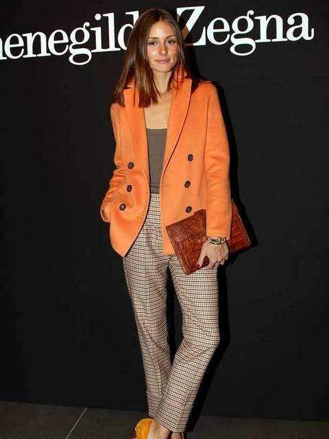 Olivia Palermo wears a pair of high waisted masculine trousers with a tangerine jacket teamed with bright Kurt Geiger shoes and her favourite Hermes clutch at the Emernegilo Zegna menswear A/W 2011 show, Milan. January 15 2011.