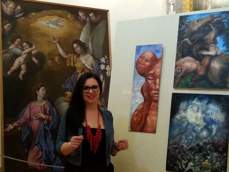 """Catia Monacelli, the Director of 9 regional Museums in Umbria (Italy) in front of Alexander Kanevsky's """"Epiphany"""", """"Rape of Sabines"""" and """"Titus Flavius"""" during the exhibition of Sacred Art in Chiesa di Santa Maria dei Laici of The Diocesan Museum Centre of Gubbio"""