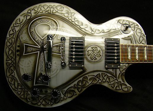 Celtic Custom Guitar. Wow, gaudy but sorta majestic in its own right. Bet it's heavy as a boat anchor! Haa! ~Rooster
