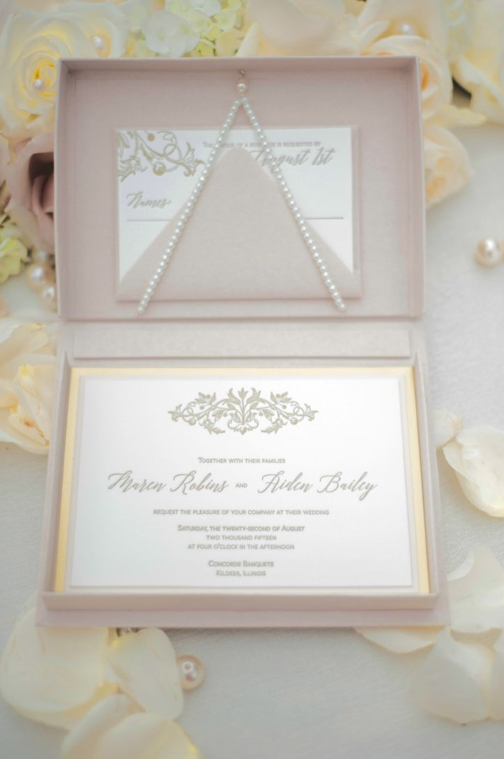Pink and gold letterpress wedding invitation in