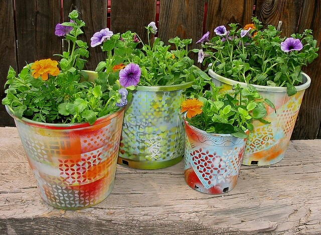 Resurfaced plastic flower pots recycled goods for Recycled flower pots