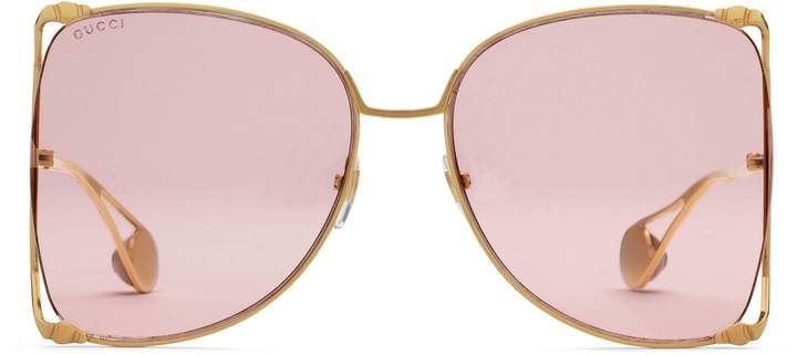 5a97c505c72 Oversize round-frame metal sunglasses. Oversize gold metal frame with butterfly  shape effect—the forked edges transform into two small snake heads on each  ...