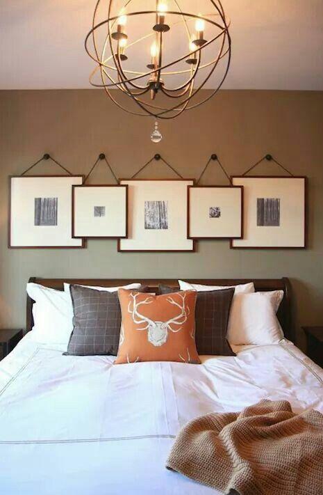 Frames hanging over bed.. Love!