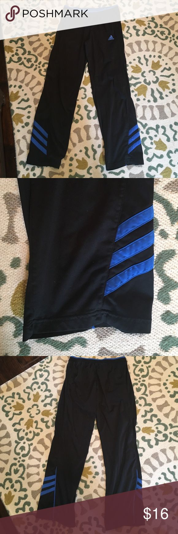 Black and Blue Adidas Sweatpants Boy's black and blue adidas sweatpants. Size medium Adidas Bottoms Sweatpants & Joggers
