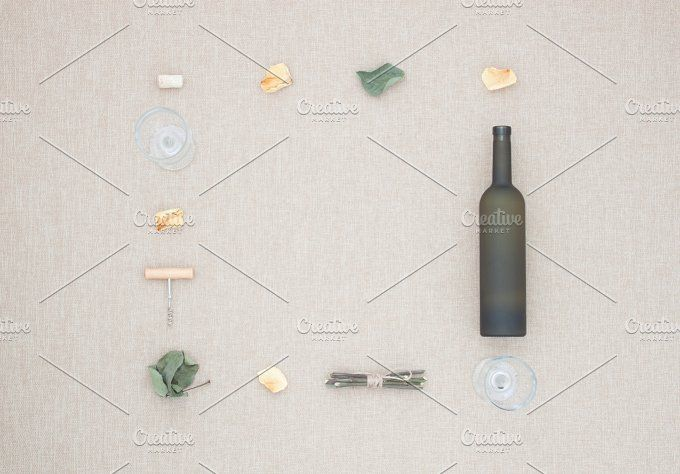 Bottle, glass, corkscrew and leaves. by Milla Mi on @creativemarket