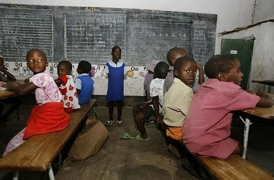 Zimbabwe primary school children sit in a teacherless in Harare, where the teachers are refusing to teach this year until they get a salary increase.