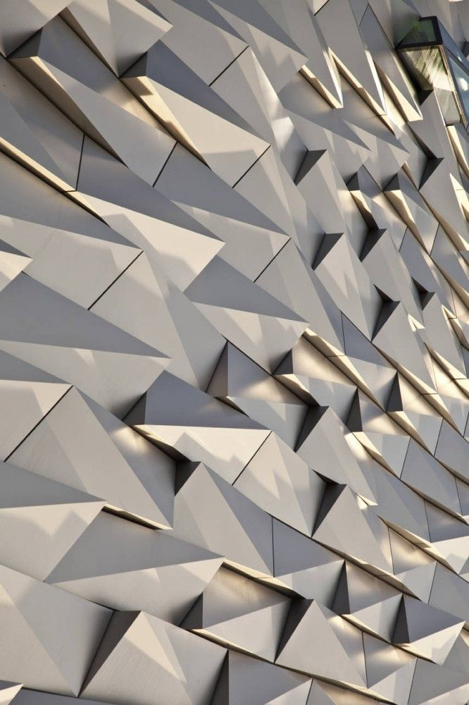 Interesting facade appearance, geometrical makes use of light  Detail of Titanic Belfast in Ireland by CivicArts & Todd Architects.