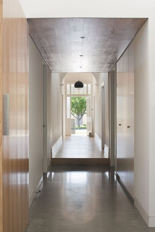 hallway | polished concrete floors + wood paneled ceiling | Canopy House - Bower Architecture
