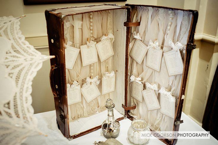Vintage wedding table plan suitcase