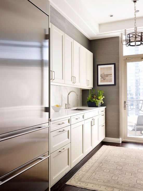 continue long wall of cabinets-coffee bar into breakfast area or cover dishwasher with panel