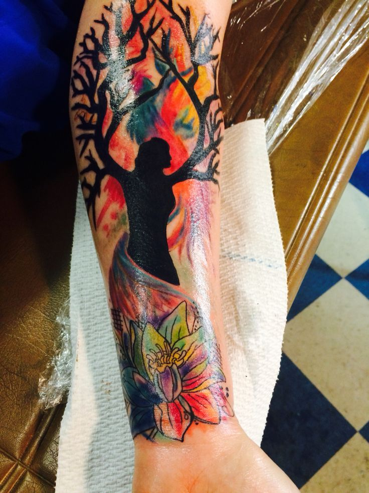 Watercolor tattoo lotus with women silhouette tree of life and Phoenix done by Zion at austin's finest tattoo shop in Austin Texas