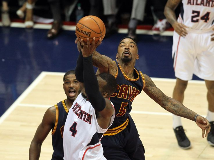 Cleveland Cavaliers guard J.R. Smith, right, and Atlanta Hawks forward Paul Millsap go for a rebound during the first quarter of game one of the Eastern Conference Finals of the NBA Playoffs in Atlanta. The Cavs won 97-89.  Brett Davis, USA TODAY Sports