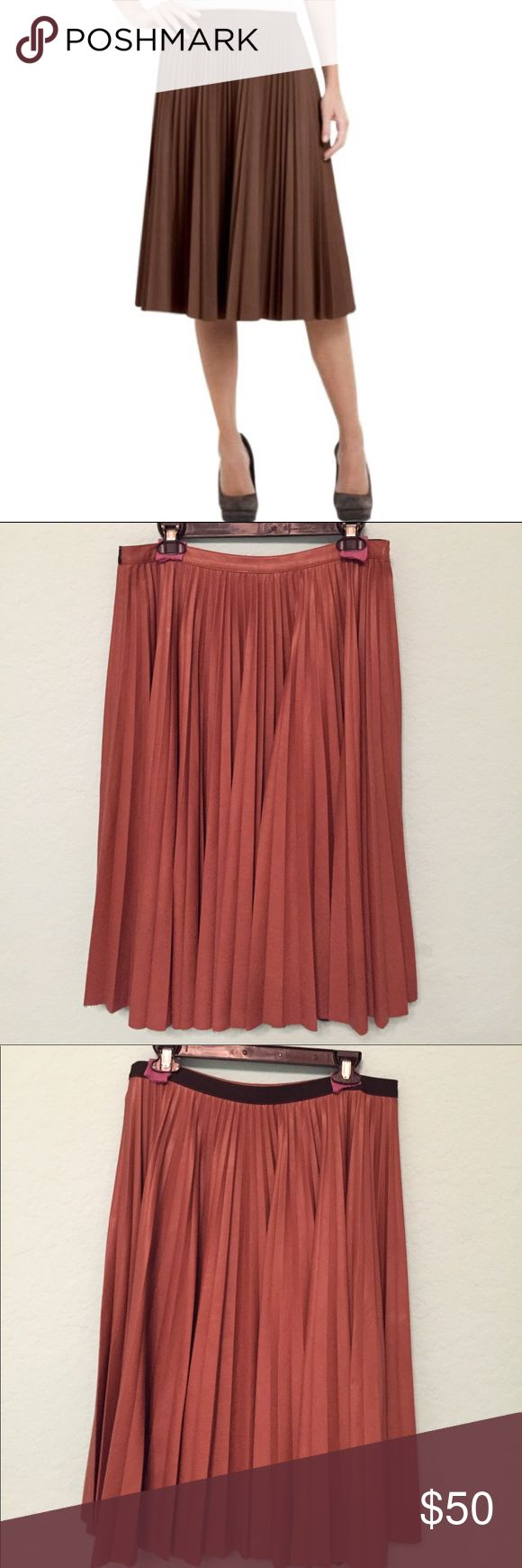 """BCBG MAX AZRIA Elsa pleated vegan leather skirt Toffee color vegan leather pleated skirt. Gentely loved. No major stains or rips. Professionally dry cleaned. Elastic waistband on the back. Length is approximately 27"""". BCBGMaxAzria Skirts A-Line or Full"""
