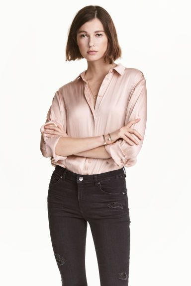 Satin blouse: Satin blouse with a narrow collar, buttons down the front, long sleeves with buttoned cuffs and a gently rounded hem. Slightly longer at the back.