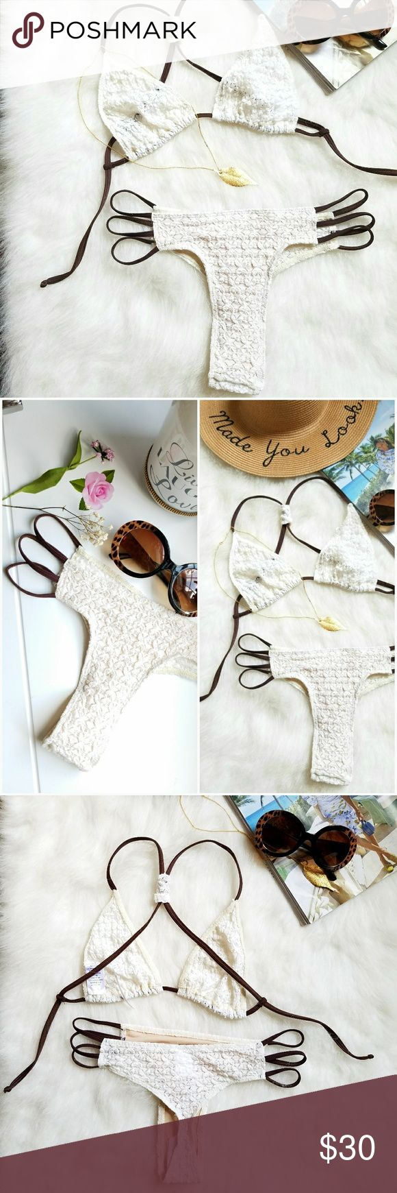 🌞👙Hottt Teeny Weeny Bikini👙🌞 NWT☆Two-Piece bikini set.  Pretty cream color with brown stretchy straps.  Material is a lacy fabric.  Sexy three strap hip design.  This is a revealing yet classy number.  If you're not afraid to flaunt it, then you will love this set.  Protective shield still intact.  A size M, but will fit XS-M. Swim Bikinis