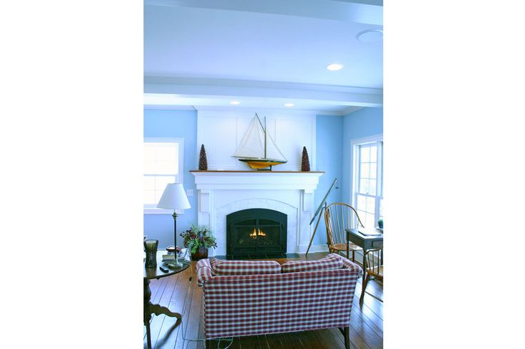 Fireplace with full wood surround and mantel and beveled pine flooring