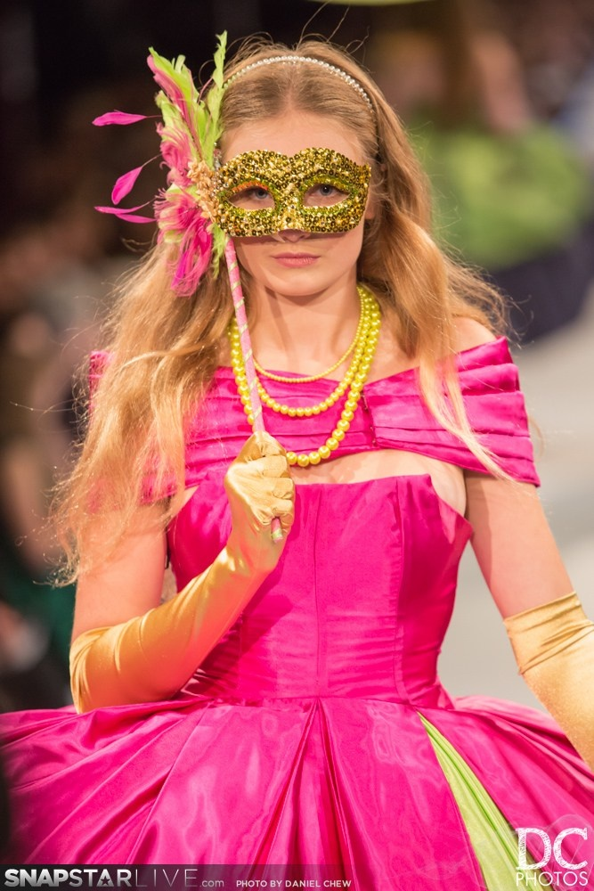 Madison Hare-Reid modeling an outfit and mask, both designed and made by Tansy Morris at iD Dunedin Fashion Week 2013
