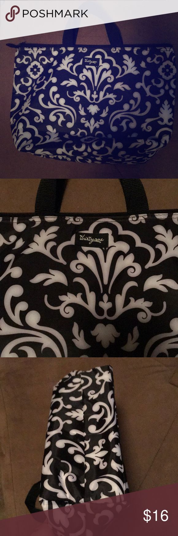 Thirty one insulated bag Thirty one insulated bag. Awesome for a lunch bag!!!! Very clean!!!! thirty one Bags
